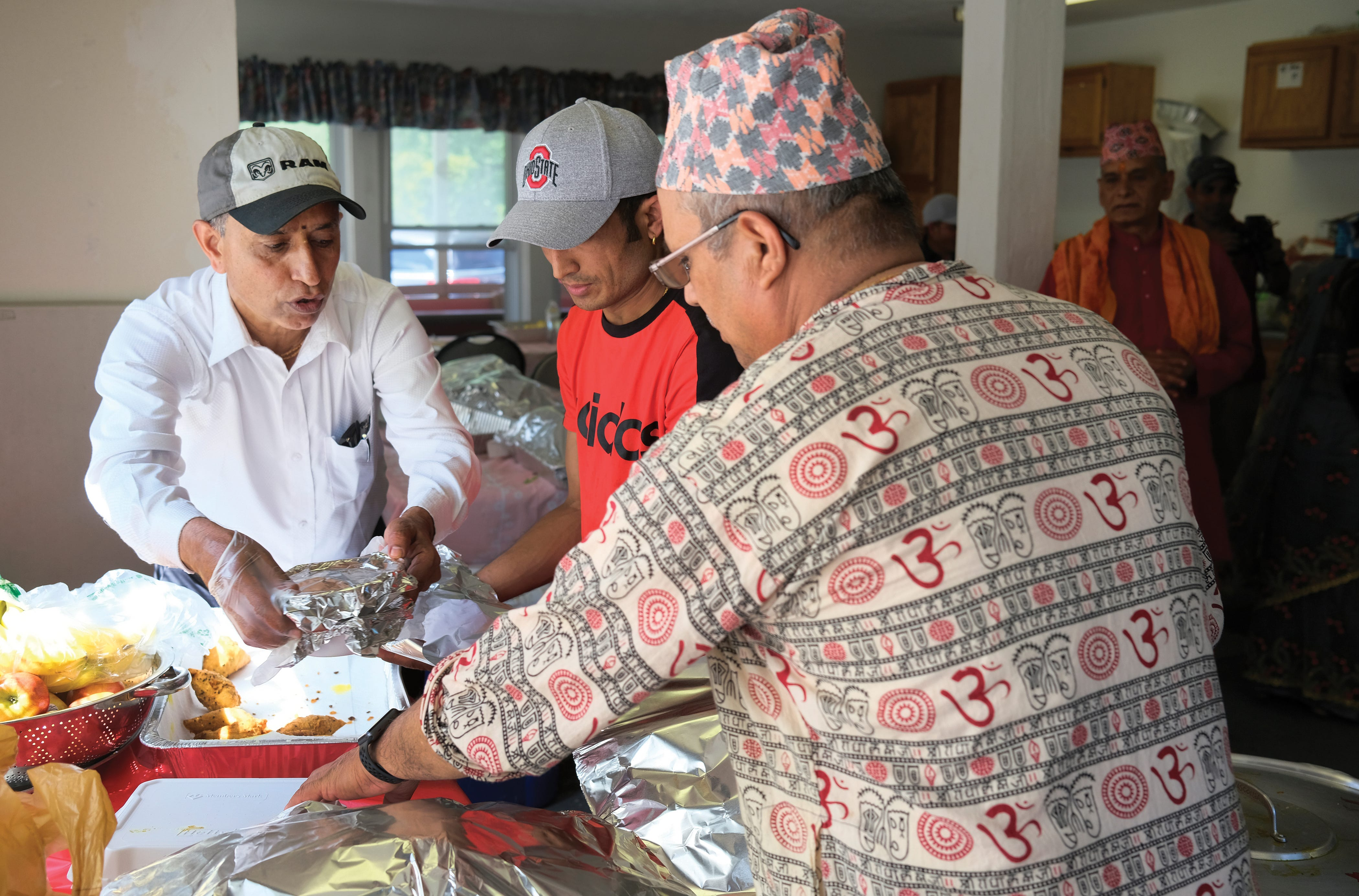 Ram Upreti helps prepare food for guests at the non-profit Vedic Welfare Society in Westerville during a Threading Ceremony.