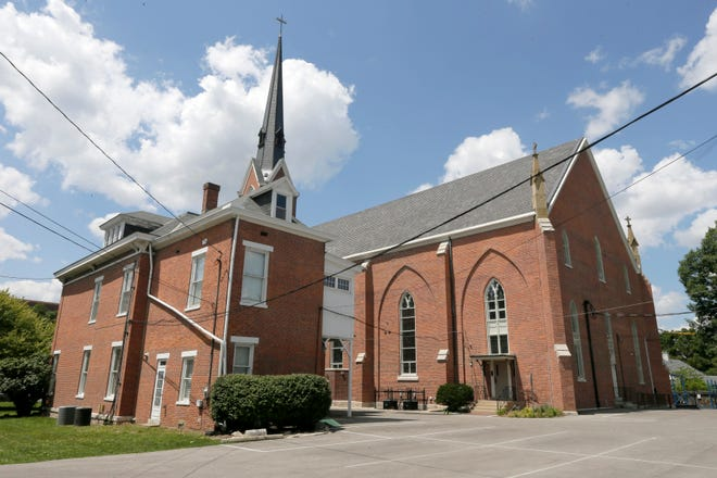 A proposal to redevelop the site of St. Mary Catholic Church in German Village would move the rectory closer to Third Street. Currently, the parish residence is set back next to the main church building.