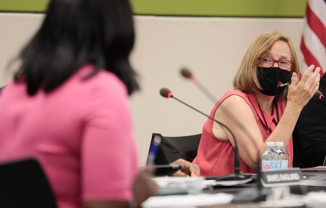 Columbus Board of Education member Carol Beckerle, right, asks a question about the number of bus drivers in the district to Superintendent Talisa Dixon, left, during a board meeting Tuesday at the Columbus City Schools South Administration Building on the South Side.