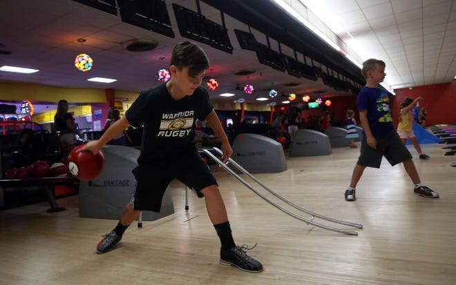 Braedyn Smith, 11, bowls at Gahanna Lanes on July 29. The bowling and activity center has been in business for 58 years.
