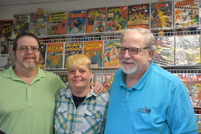 More Fun Comic Studio opened in Asheboro on Monday. Pictured from left are Chris Wallace, Pamela Bowen and Rick Davis. Wallace is a family friend, and Bowen is Davis' daughter.