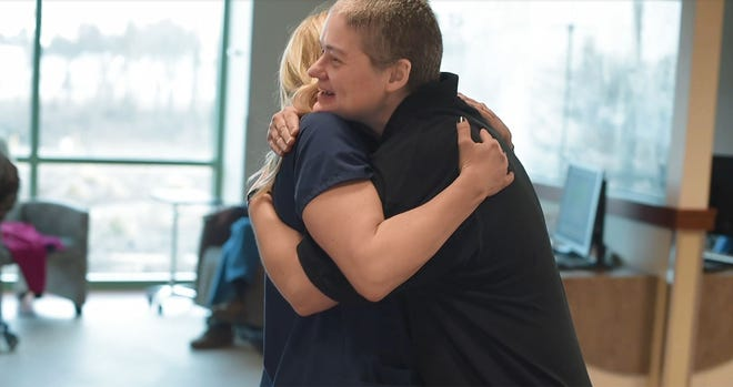 A nurse at the hugs a patient in the cancer program facility at Wooster Community Hospital, which received  Three-Year Accreditation from the Commission on Cancer.