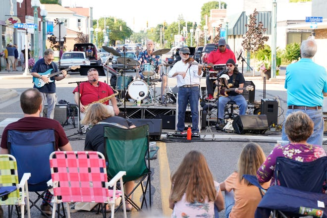 """Bille Lewis and the Soulbacks are seen performing in front of a crowd during the July edition of downtown Adrian's First Fridays. The August First Fridays is Aug. 6 and is themed """"Dog Days of Summer."""" A pet parade will be held as will canine contests with many prizes."""