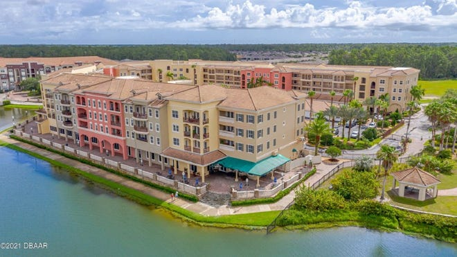 This beautiful four-bedroom, three-and-a-half-bath condo is in the Tuscany Square community, within Venetian Bay, where optional memberships are available for the golf club, swimming club and tiki bar.