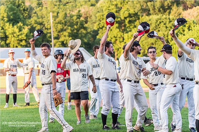 The Dansville Gliders tip their caps and salute the fans at the end of the NYCBL franchise's first season in Dansville this summer.