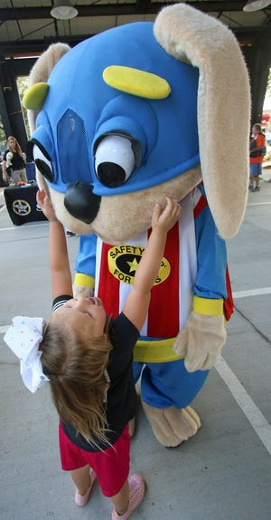 """Four-year-old Georgia Allen asked """"Safety Pup"""" for a hug during the National Night Out held Tuesday evening, August 3, 2021, at the City Pavilion on East Marion Street in Shelby."""