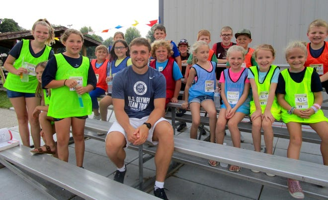 Will Daniels, who recently competed in the Olympic Trials in Oregon, spoke to the youth at the Grace United Methodist Church Mini-Vacation Bible School held Sunday in Geneseo. He also spoke to at the church's family swim event in the evening.