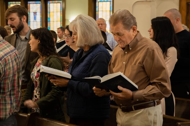 Joe Moore, right, and other members of the Bloomington Reformed Presbyterian Church sing a cappella from a Psalter, the book of Psalms set to music.