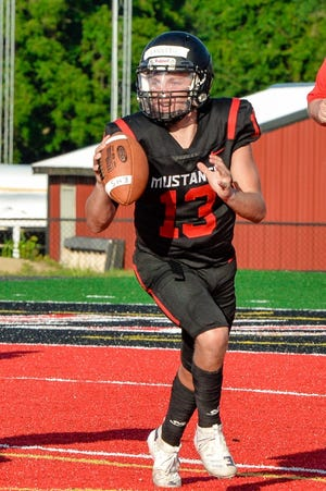 Junior Jakob Lanning (13) is in a competion with sophomore Andrew Good to be named starting quarterback at Edgewood this season. Lanning, a backup last year, appeared in eight games and also played in the secondary.