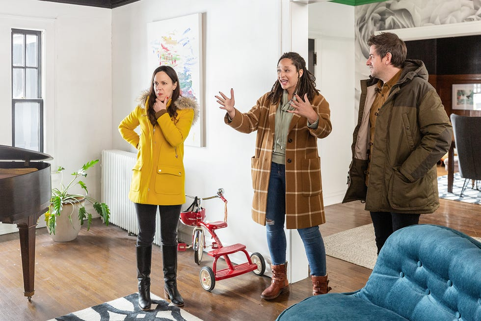 """Reagan Leslie, center, shows the hosts of """"Cheap Old Houses,"""" Elizabeth and Ethan Finkelstein, around her Peoria home during filming Jan. 9."""