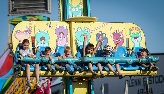Youngsters on the Frog Hopper at the Monroe County Fair.