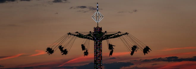 The Wave swings in the dusk sky above the Monroe County Fair last Monday evening.