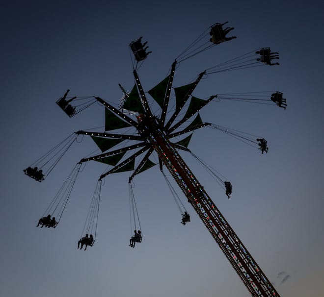 The wave swinger in the dusk light at the Monroe County Fair.