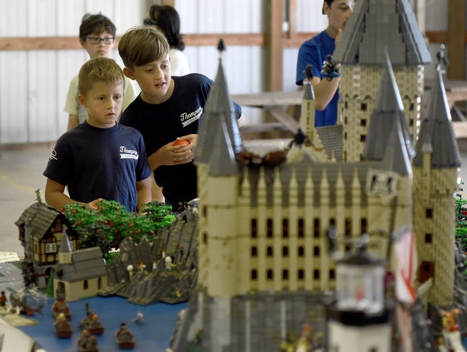 Nathan Bub, 8, and his brother Lucas, 9, of Petersburg take a close look at the Lego city that was on display last week at the Monroe County Fair. The display was assembled by the Michigan Lego User Group (MichLUG), which has shown its models at various shows and conventions since the early 2000s.