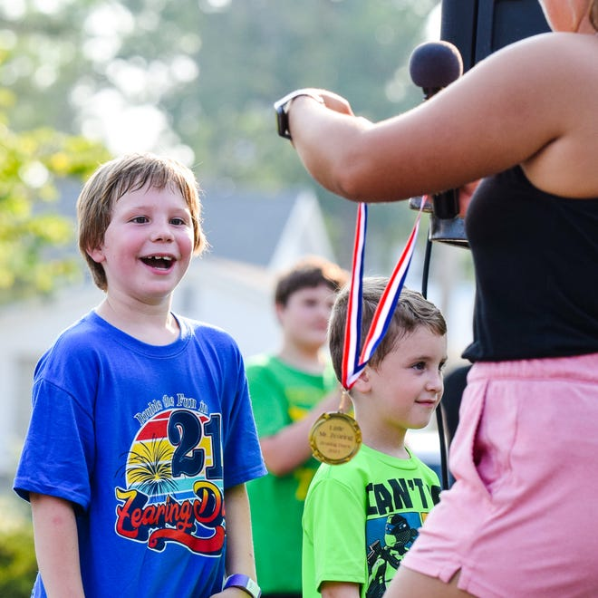 """Tommy West reacts to being crowned """"Little Mister Zearing"""" during opening ceremonies for Zearing Days at City Park in Zearing on July 24."""