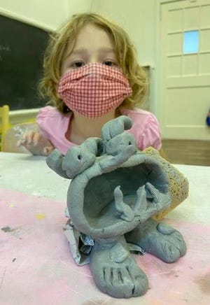 A child plays with clay at a previous Children's Museum of Oak Ridge Fall Camp.