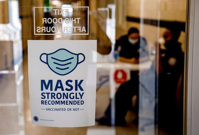 Signs at Oklahoma City City Hall encourage wearing masks, regardless of vaccination status.