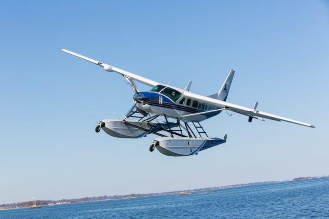 A Tailwind Air Cessna Grand Caravan EX in flight over Boston Harbor.