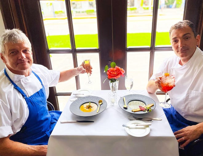 Cafe L'Europe chefs Alain Krauss, left, and Benoit Delos enjoy some of the cold soups that the restaurant has featured this summer.