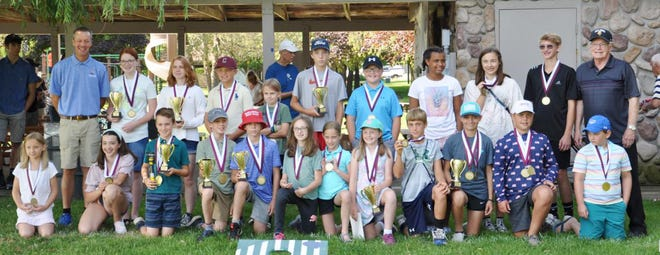 Davenport Tournament Champions and skill champion winners in putting, pitching, chipping, and driving included (front, from left) Caroline Kolka, Bella Waterman, Tyler Swanson, Maxwell Drenth, Landon Whisler, Hannah Muladore, Katrina Selph, Olivia Migda, Colin Jess, Maggie Sheaffer, Greyson Warchol, Michael Brody (back) Program Director Doug Drenth, Ainsley Cecil, Sarah Pletcher, Lucas Strahan, Lily Kimbel, Ben  Strange, Max Muladore, Tori Carroll, Josie Kolka, Jurgen Griswold and Executive Director Dean Davenport.