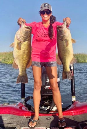 StacyBarawedholds up two largemouth bass up to7 pounds,5ouncescaughtand released on the Delta out of Paradise Point Marina in Stockton this July.