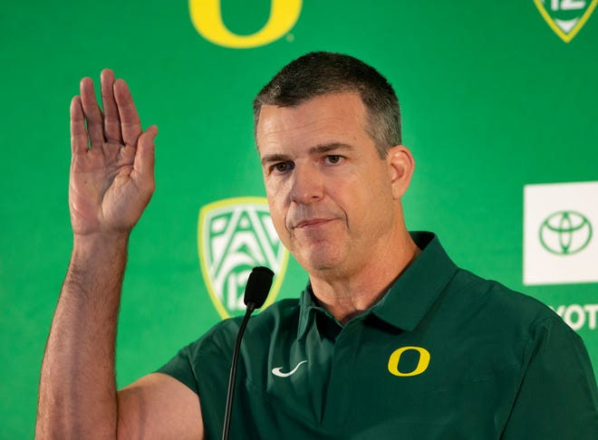 Mario Cristobal takes questions from the media during a media day session earlier this week.