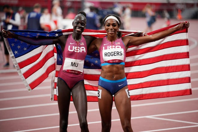 Gold medalist Athing Mu, left, and bronze medalist Raevyn Rogers react after their finish in the women's 800 final during the Tokyo Olympics.