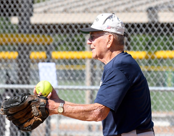 John Wellock, 92, of Coventry Township, catches for Akron Monument & Granite in Silver League softball at Willig Field in Canton.