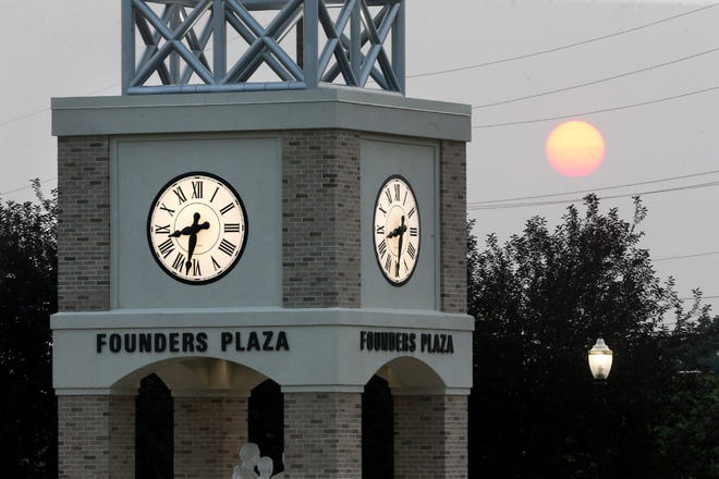 The sun sets behind Founders Plaza on the campus of Walsh University in North Canton on Sunday, July 18, 2021.