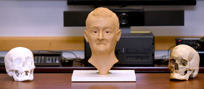 State and local authorities this week unveiled a clay model of an unidentified man whose bones were found in March 2020 in a field off Sandy Avenue SE in Pike Township. Officials are hoping someone can identify the man.