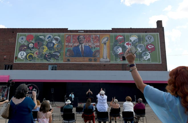 """A banner mural was unveiled on Tuesday afternoon commemorating Pete Rozelle being named NFL commissioner in 1960. The artwork, by Stark County artist Tommy Morgan, is part of """"The ELEVEN,"""" a project of ArtsinStark and the Pro Football Hall of Fame undertaken with the support of sponsors."""