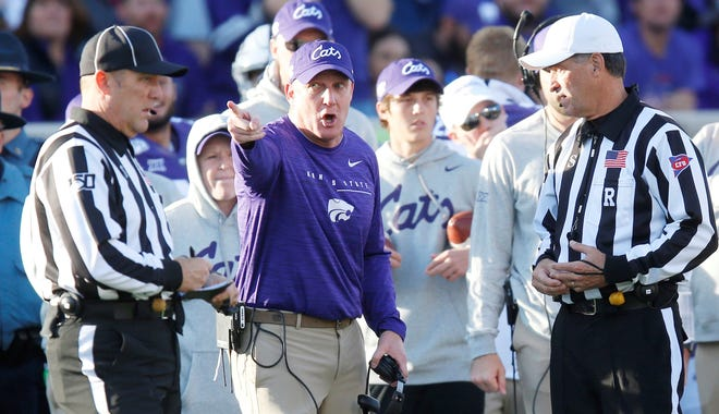 Kansas State head coach Chris Klieman, center, argues a call with officials during a 2019 game. Klieman said last week in a radio interview that he is confident in the Wildcats' football future with Big 12 Conference realignment looming.