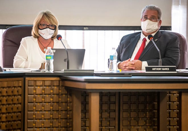 Superintendent Jennifer Gill, left, proposes District 186's Return to Learn plan that will include universal masking during a Springfield District 186 Board of Education meeting along with Board President Anthony Mares, right, at the District 186 headquarters in Springfield, Ill., Monday, August 2, 2021. [Justin L. Fowler/The State Journal-Register]