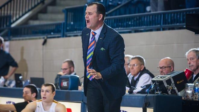Oklahoma Baptist University men's head basketball coach Jason Eaker shouts out instructions during the 2020-21 season.