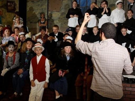 Kewanee native Bryan Blanks works to inspire a group of young actors during a practice run.