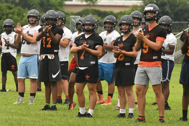 New Hanover High School hit the practice field early Tuesday Aug 3, 2021. Local area high schools are all starting football practice this week to get ready for the 2021 season.  [KEN BLEVINS/STARNEWS]
