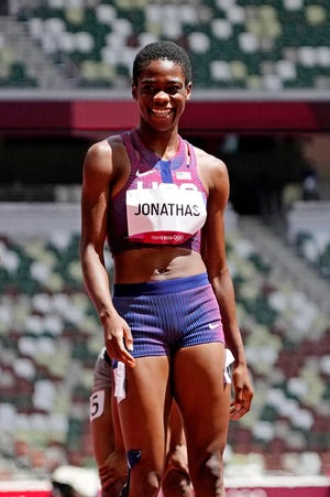 Former Doherty High standout Wadeline Jonathas sports a smile on the Olympic track Tuesday and is on her way to the women's 400-meter semifinals.