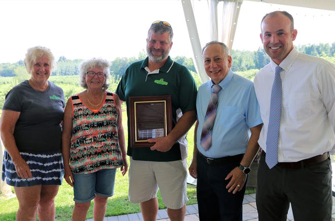 At Meadowbrook Orchards for the Sterling Economic Development Committee are (from left) owner Kathy Chandler, Select Board Chair Maureen Cranson, owner David Chandler and EDC Chairman James Patacchiola with committee member Kaith Cordial.