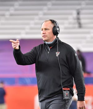 N.C. State Wolfpack head coach Dave Doeren calls to a referee in the first quarter against the Syracuse Orange at the Carrier Dome during the teams' Nov. 28 meeting.