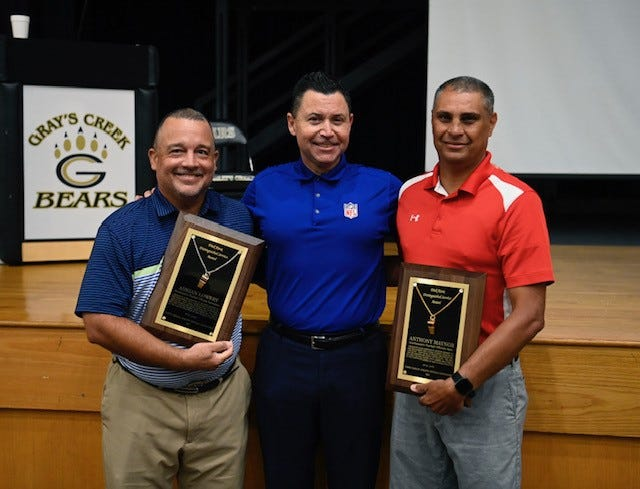 Lumberton's Adrian Lowery, left, and Pembroke's Anthony Maynor, right, were recently awarded the NCHSAA's Dick Knox Distinguished Service Award for their work as game officials. Lumberton native Brad Allen, center, helped present the awards.