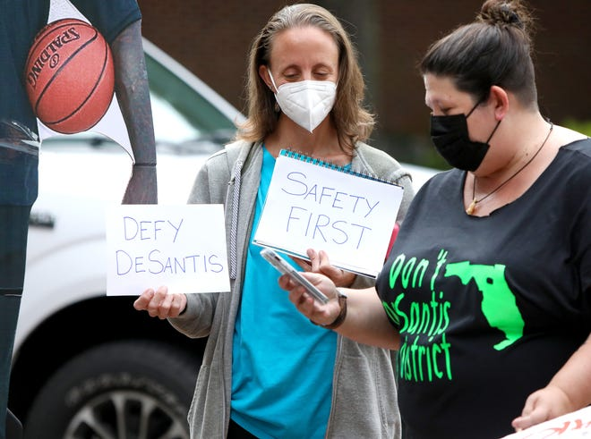 Parents with the Education Advocates of Alachua County take part in a rally to show support that kids should be required to wear face coverings in Alachua County Schools this year, outside the Alachua County Administration Building in Gainesville on Aug. 3.