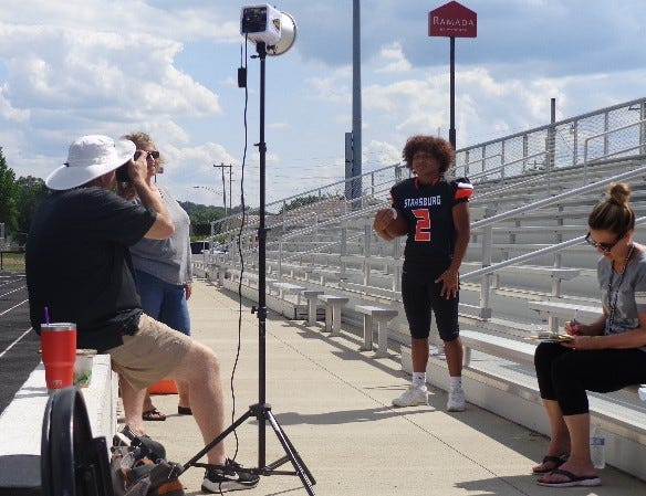 Denny Trimmer and his Solid Rock Photo staff take Strasburg's fall sports photos at Ron Hurst Field in Strasburg Tuesday afternoon.