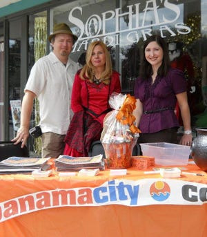 The PanamaCity.com crew (from left, Tony Simmons, Karen Bednarcyk and Jan Waddy) is shown on Halloween week 2011, handing out promotional stickers and so forth in St. Andrews.