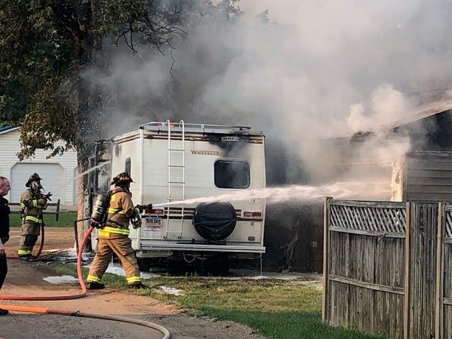 A recreational vehicle and garage on Maple Street were destroyed in a Monday evening fire.