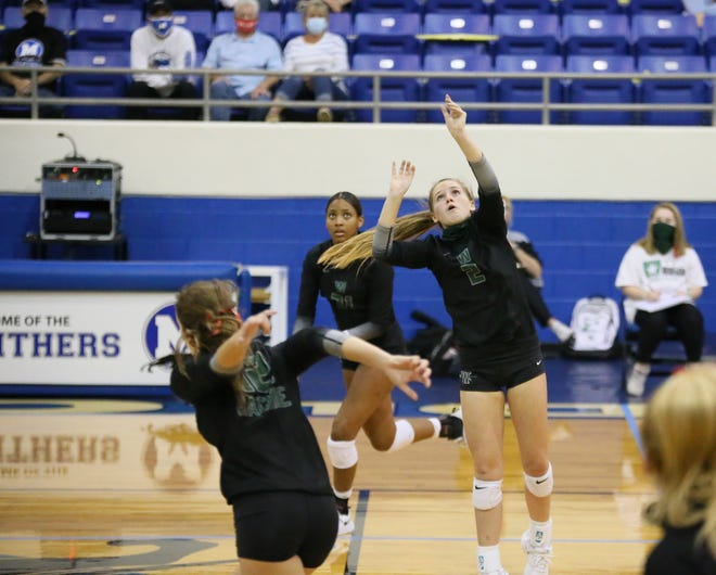 Waxahachie setter Madison Fuller (2) moves into position during a non-district match at Midlothian last September. The Lady Indians will travel to Red Oak for a preseason scrimmage on Friday to begin 2021 volleyball action.