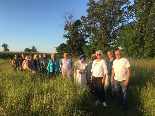 The Earth, Wind and Flowers Garden Club walked through the 11-year-old prairie this week as Cheryl Corney and Mary Lee Minor identified native plants.