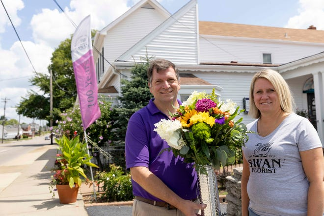 Dave Schreiver, left, and his sister, Lynne Brauch, both fourth-generation owners of Swan Floral and Gift Shop, pose for a portrait, Tuesday, Aug. 3, 2021, at the store in Erlanger, Ky. Six siblings own Swan Floral and the store, founded in Fort Mitchell in 1921, is celebrating its 100th year anniversary.