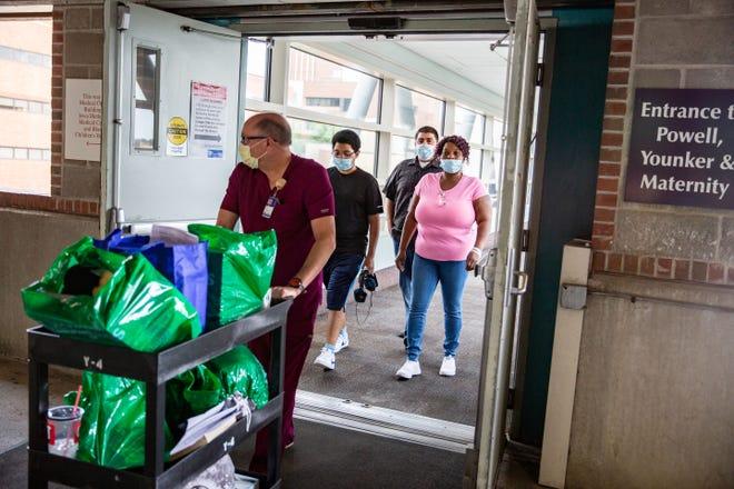 David Jaramillo, 16, and his parents David and Sabrina Jaramillo leave Blank Children's Hospital in Des Moines Tuesday, Aug. 3, 2021.