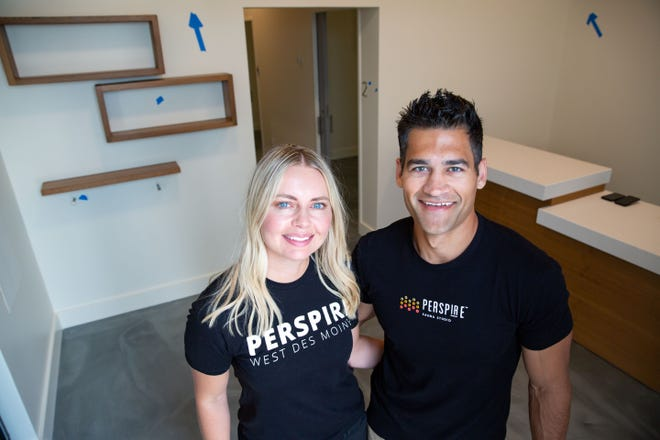 Lauren and Michael Caleb, owners of Perspire Sauna Studio stand for a photo at the soon to be opened West Des Moines location, Tuesday, Aug. 3, 2021.