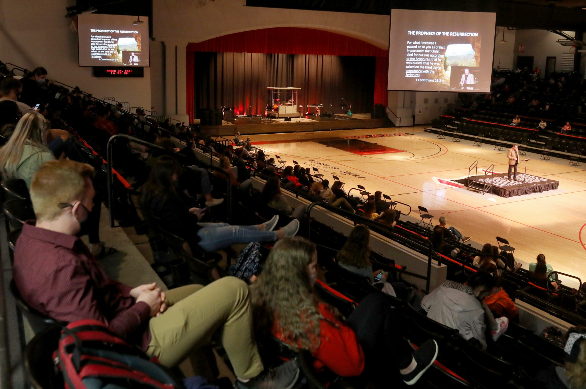 Students listen to Tiberius Rata preach on Tuesday, March 30, 2021.